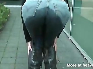 Pee jeans at the car dealership.