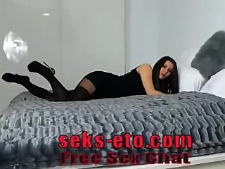 She wants sex on webcam, inviting in private chat. Woman in black.