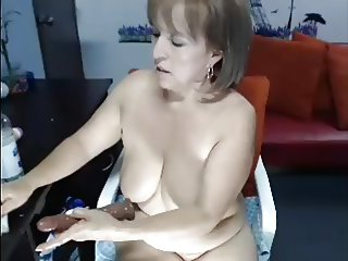Mature big boobs....dildo in her ass