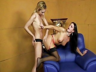 Girl on girl pussy teasing with strap on