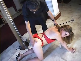 Tgirl slave gets bound and paddled