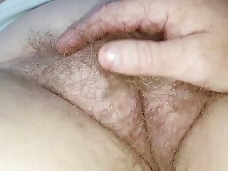 closeup of my fingers going through her hairy bush