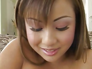 Asian sucks & fucks a big hard cock