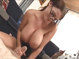 Hot milf with big tits jerking a cock