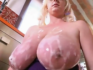 horny housewife  soaps up her massive boobs in her kitchen