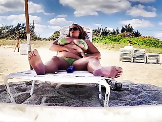 Showing off my pussy on the beach