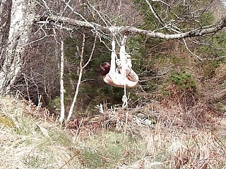 Naked self-bondage in the woods gone wrong.
