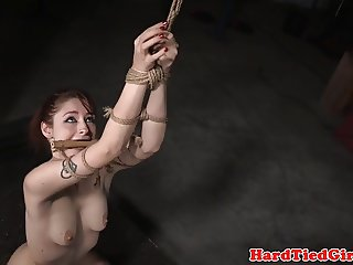Bondage sub hogtied as prep for whipping
