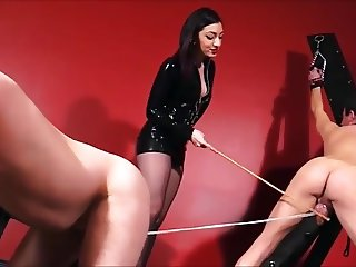 Mistress whips, cane and CBT 2 slaves