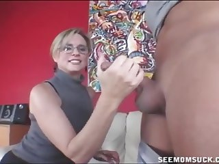 Hot milf sucks a young dude's cock