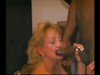 Rich woman milks all of the bbc with her mouth.