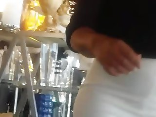 Candid big booty milf in tight white pants.