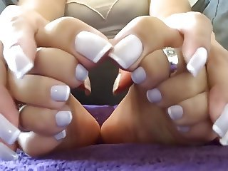 beauty woman show her Hands and feet in French nails style