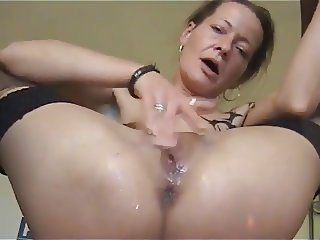 Mature babe masturbating while peeing