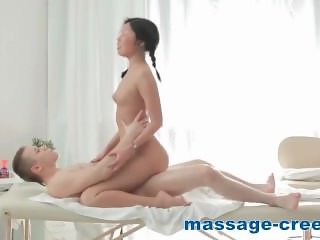 Asian with small tits sucking cock of masseur
