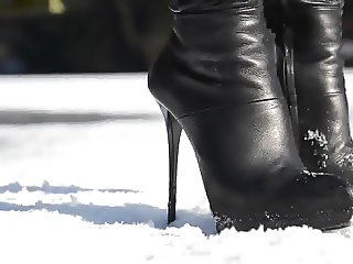 julie skyhigh walking on ice, high heels boots leather skirt