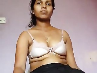 Desi girl stripping and masturbating with a big black dildo