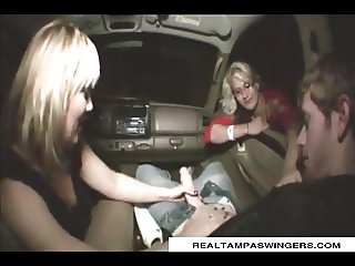 Tag Team Cock Handjob In The Car