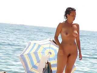 2 Women Standing Nude And Topless On Beach (2)