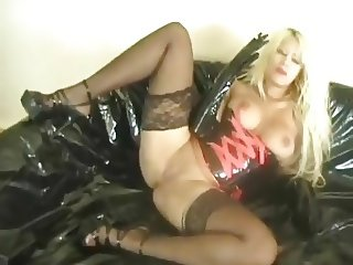 Smoking blonde in latex playing