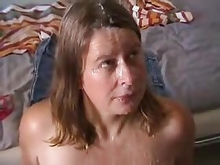 MILF takes 2 huge facials from black and white cocks