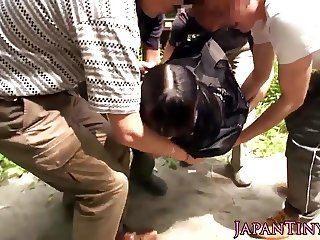 Japanese petite fucked outdoors in threesome