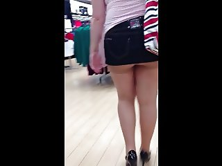 Disgustingly short skirt and tights