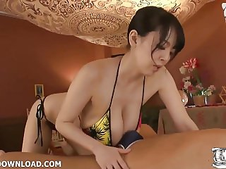 Busty asian with huge breasts in bikini