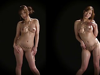 Stunning babe wearing only gold chains shows her ass for the camera
