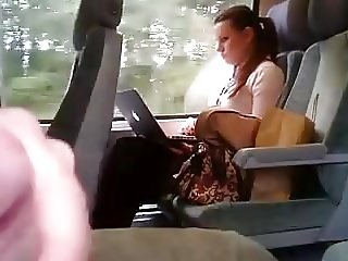 Girl on train distracted by wanker