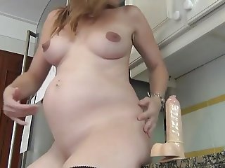Show of a pregnant housewife in front of the camera