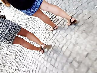 Walking Sexy tanned legs, feets, hot red toes, in mini skirt