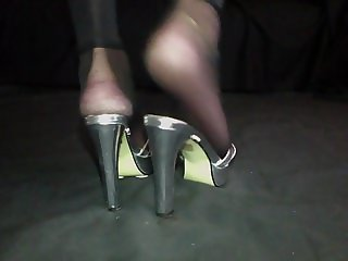 Feet show in heels and nylon