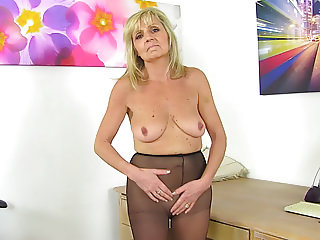 English gilf Dolly puts a dildo to work on her craving cunt