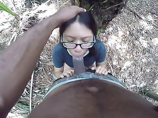 Nerdy Asian fucks BBC in park then drinks cum