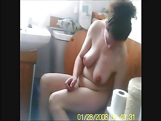 Voyeur capture naked big tits wife shaving legs on toilet