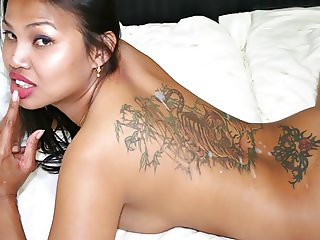 Thai slut with ruby red lips getting fucked doggy style hard