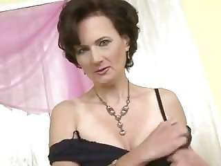 Stunning mature shows off her pussy