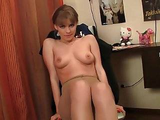 Cute russian girl Zina strips and poses on stockings