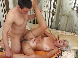 MILF and GILF suck and fuck two young sons