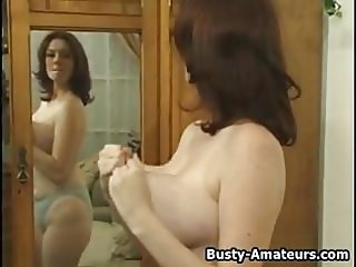 Busty Kathryn playing with her huge tits
