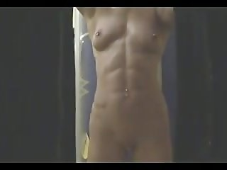 muscular woman in the shower