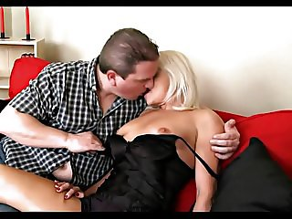 horny mature couple makes love on the couch