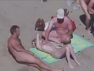 Cuckold couple on the beach