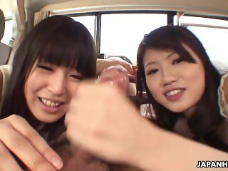 Two adorable Asian teen hitchhikers suck cock in the car