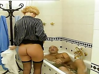 Maid surrounded by sex and get's carried away