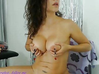 Big breasted girl plays with nipples and clamps!