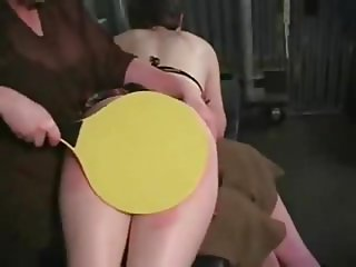 Woman disciplines young woman
