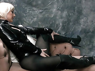 Busty blonde fingers wet pussy in latex and leather boots
