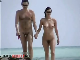Exciting view of nude girl on beach hunter